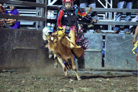 Rainbow kid 1 - Bull riding - Kyogle Show